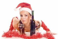 Santa girl drinking Royalty Free Stock Image