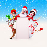 Santa with girl and elves and a big sign Stock Photography