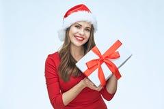 Santa Girl en presentes rojos de la tenencia fotografía de archivo libre de regalías