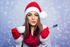 Santa girl enjoying coffee in winter Stock Photos