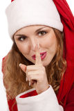 Santa girl with finger on lips Stock Photos