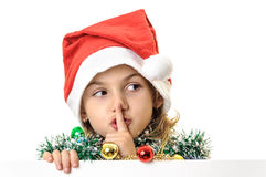 Santa girl finger over lips quiet sign Stock Images