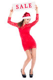 Santa girl in full growth shows Banner sale. Christmas discounts Stock Photography