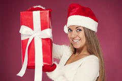 Santa girl with gift Royalty Free Stock Photography