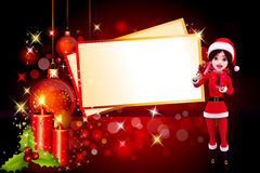 Santa girl with gift and a big christmas card Stock Images