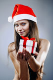 Santa girl with gift box Stock Photography