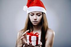 Santa girl with gift box royalty free stock images