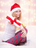 Santa girl with gift box Royalty Free Stock Image