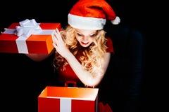 Santa girl with gift box Royalty Free Stock Photo