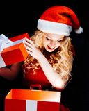 Santa girl with gift box Stock Photos