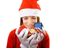 Santa girl with gifts Royalty Free Stock Image