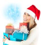 Santa girl with gifts Royalty Free Stock Photo