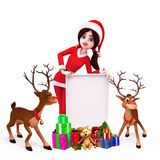 Santa girl with gifts and sign, reindeer Stock Photos