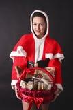 Santa girl gives us a Christmas gift basket Stock Image