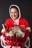 Santa girl gives us a Christmas gift basket Stock Image