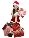 Santa girl giving a present Stock Photos