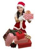 Santa girl giving a present Stock Photos