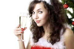 Santa girl with a glass of champagne Stock Photos