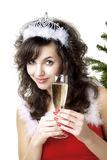 Santa girl with a glass of champagne. Images of the beautiful Santa girl with a glass of champagne Royalty Free Stock Images