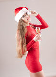 Santa girl  with glass of champagne. Stock Images