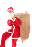 Santa Girl with a gunnysack with a lots of presents, isolated on Royalty Free Stock Photography
