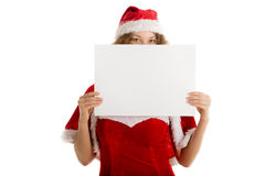 Santa girl hides behind blank paper Stock Photos
