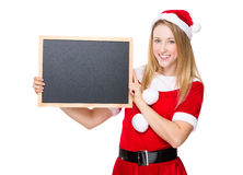 Santa girl hold with chalkboard Stock Photo