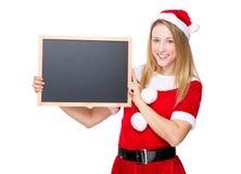 Santa girl hold with chalkboard Stock Photo