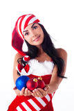 Santa Girl Holding A Christmas Ball Stock Photography