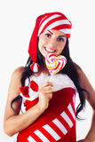 Santa Girl Holding A Lollipop. Stock Photos