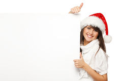 Santa girl holding billboard showing thumb up Stock Photography