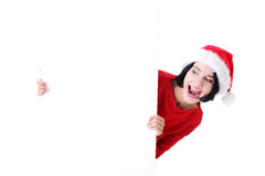 Santa girl holding blank board Stock Image