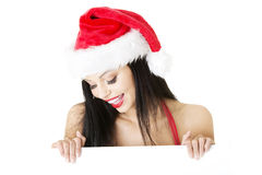 Santa girl holding blank board Stock Images