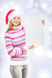 Santa girl holding blank sign Royalty Free Stock Images