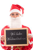 Santa Girl holding a board with german text, isolated on White, Royalty Free Stock Photo