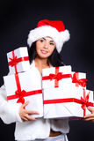 Santa girl holding the box with gifts. Holidays New Year and Christmas Royalty Free Stock Images