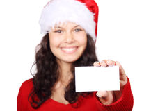 Santa girl holding business card. Cute Santa woman holding a business card isolated on white background Royalty Free Stock Images