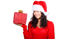 Santa girl holding a christmas gift. Isolated on white background Stock Photos