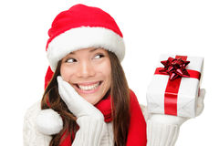 Santa girl holding christmas gift stock images
