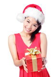 Santa girl holding christmas gift stock photos