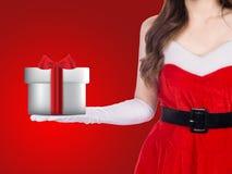 Santa girl holding christmas gift Stock Photo