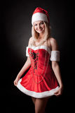 Santa girl is holding Christmas gifts. stock photography