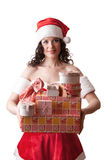 Santa girl is holding Christmas gifts. Royalty Free Stock Images
