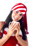 Santa girl holding a cup, drink. Stock Images