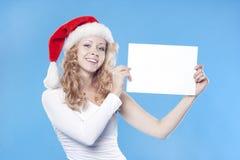 Santa girl holding empty blank Royalty Free Stock Photos