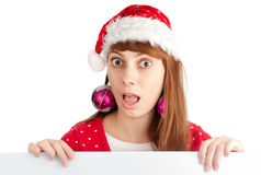 Santa girl holding empty board Royalty Free Stock Image