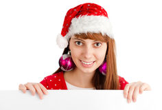 Santa girl holding empty board Royalty Free Stock Photography