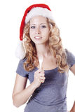 Santa girl holding a fork Royalty Free Stock Photos
