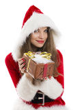 Santa girl holding a gift box. Royalty Free Stock Image