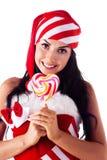 Santa girl holding a lollipop. Stock Image